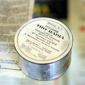 """Tho-radia powder"""" box, """"based on radium ad torium, according to the formula by Dr Alfred Curie"""", on display at the Musée Curie, Paris. An example of radioactive quackery"""